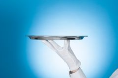 Waiter carrying empty tray Stock Images