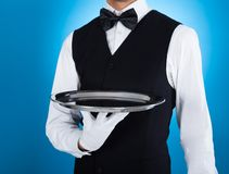 Waiter carrying empty tray Royalty Free Stock Photos