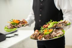 Waiter. Carrying plates with food Stock Photo