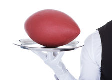 Waiter Carrying Rugby Ball Stock Image