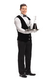 Waiter carrying a tray with wine Stock Image