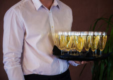 Waiter with champagne Royalty Free Stock Photography