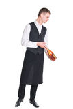 Waiter with champagne bottle Royalty Free Stock Image