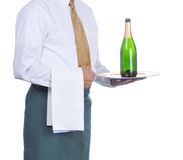Waiter with Champagne Bottle on Tray stock photo