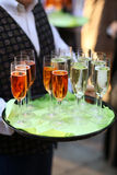 Waiter with champagne glasses stock image