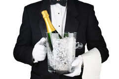 Waiter with Champagne Ice Bucket. Closeup of a Sommelier holding a Champagne Ice Bucket in front of his torso. Horizontal format on white Royalty Free Stock Photo