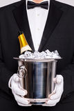 Waiter with Champagne in a silver bucket stock image
