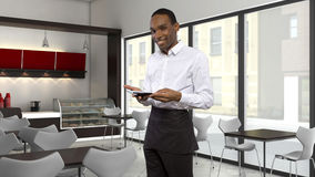Waiter in a Coffeeshop Royalty Free Stock Photography