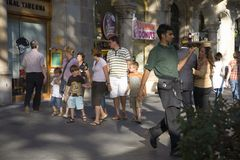 Waiter delivering drinks at outdoor caf� on Passeig de Gr�cia in the Eixample district, busy street in Barcelona, Spain, Europ Royalty Free Stock Images