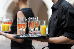 Waiter with dish of wine and juice glasses. Waiter with dish of champagne, wine and juice glasses Royalty Free Stock Image