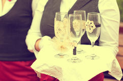 Waiter with empty champagne glasses Stock Photo