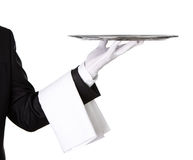 Waiter with empty silver tray. Waiter holding empty silver tray isolated on white background with copy space Stock Photos