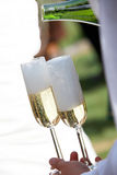 Waiter filled champagne glasses Royalty Free Stock Image