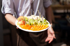 Waiter with fruits on tray Stock Images