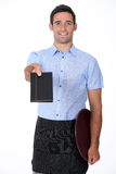 Waiter giving back a wallet Stock Images