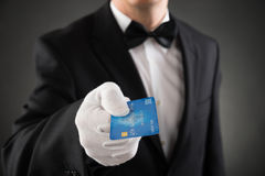 Waiter Giving Credit Card. Close-up Of Waiter In Suit Giving Credit Card Stock Photography