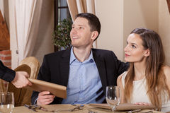 Waiter giving menu Stock Photography