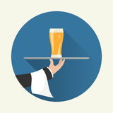 Waiter with glass of beer Stock Image