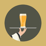 Waiter with glass of beer Royalty Free Stock Images