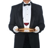 Waiter with Glass of Red Wine on Tray Royalty Free Stock Image