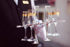 Waiter with glasses of champagne. Capture of Waiter with glasses of champagne Royalty Free Stock Photos