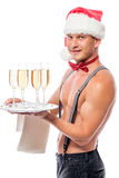 Waiter with glasses of champagne in a  hat Royalty Free Stock Photos