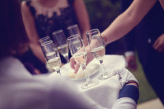 Waiter with glasses of champagne Royalty Free Stock Photos