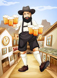 A waiter with glasses of cold beers Royalty Free Stock Photos