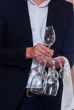 The waiter with glasses Stock Images