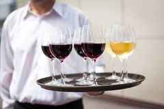 Waiter with glasses with wine Stock Photography