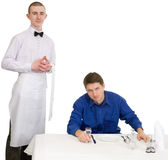 Waiter and guest of restaurant Stock Images