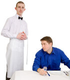 Waiter and guest of restaurant Stock Image