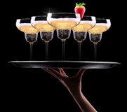 Waiter hand with champagne Royalty Free Stock Image