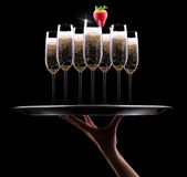 Waiter hand with champagne Stock Photo