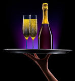 Waiter hand with champagne Stock Image