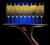 Waiter hand with champagne Royalty Free Stock Images