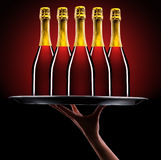 Waiter hand with champagne Royalty Free Stock Photography