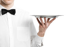 Waiter hand with metal plate. Tray isolated Royalty Free Stock Photo