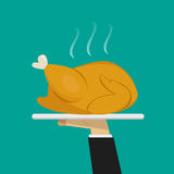 Waiter hand serving Roasted chicken on plate Stock Images