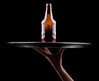 Waiter hand and tray with Beer Royalty Free Stock Photography