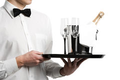 Waiter hands champagne in bucket. Waiter hands with champagne bottle in metal bucket and stemware on tray Stock Photography