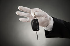 Waiter Hands Holding Car Key Royalty Free Stock Images