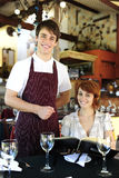 Waiter and happy costumer at the restaurant. Portrait of a waiter and happy costumer at the restaurant royalty free stock photography