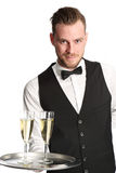 Waiter in his 20s serving champagne Stock Image