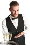 Waiter in his 20s serving champagne Stock Photos
