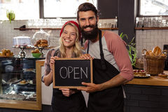Waiter holding blackboard with open Royalty Free Stock Photography