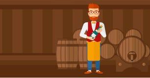 Waiter holding bottle of wine. Royalty Free Stock Images