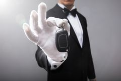 Waiter Holding Car Key stock photos