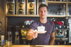 Waiter holding coffee cup Stock Image
