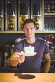 Waiter holding coffee cup Royalty Free Stock Photo